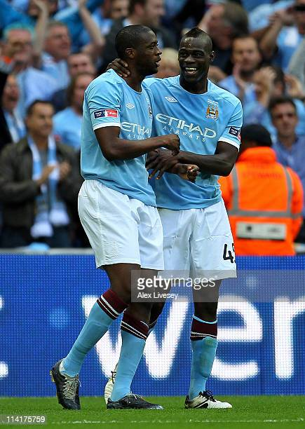 Yaya Toure of Manchester City celebrates with Mario Balotelli after scoring the opening goal during the FA Cup sponsored by EON Final match between...