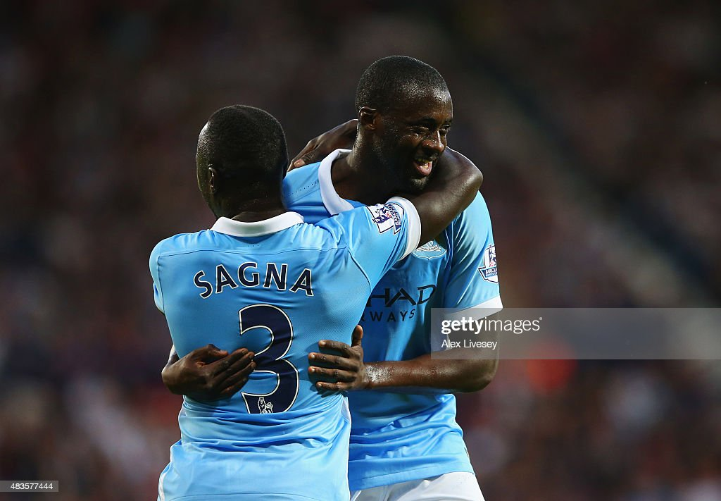 Yaya Toure of Manchester City (R) celebrates with team mate Bacary Sagna as he scores their second goal during the Barclays Premier League match between West Bromwich Albion and Manchester City at The Hawthorns on August 10, 2015 in West Bromwich, England.