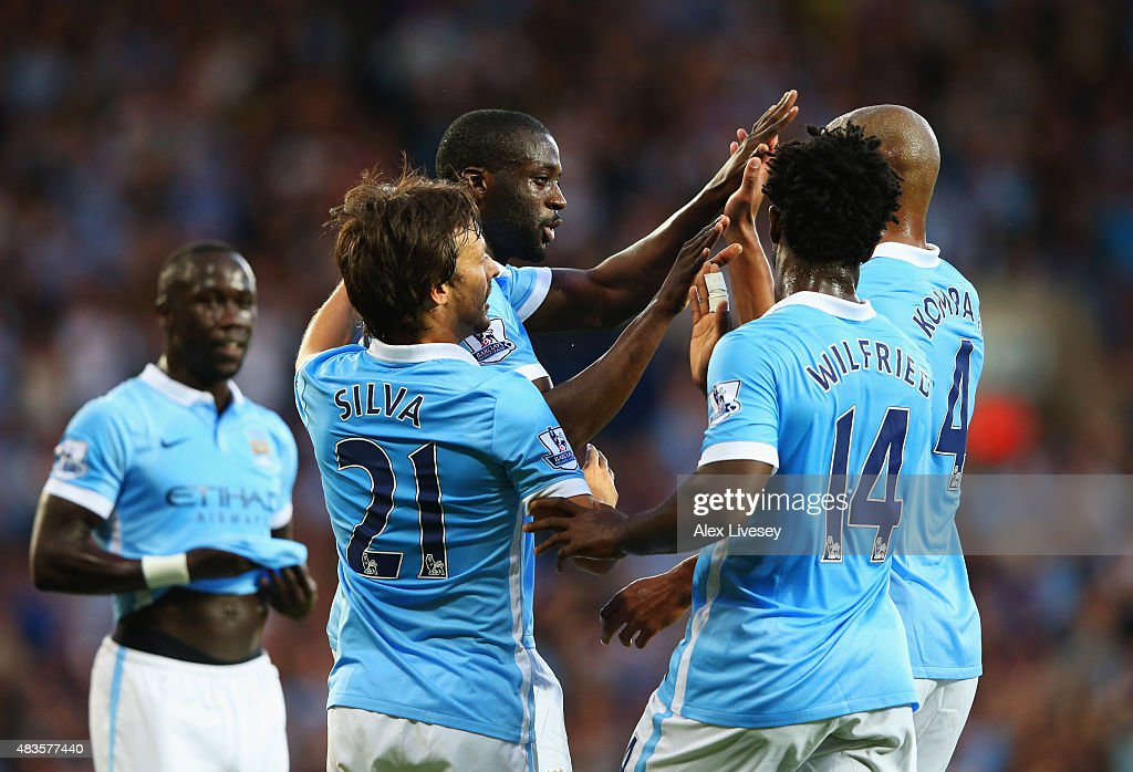 Yaya Toure of Manchester City (C) celebrates with team mates as he scores their second goal during the Barclays Premier League match between West Bromwich Albion and Manchester City at The Hawthorns on August 10, 2015 in West Bromwich, England.