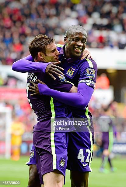Yaya Toure of Manchester City celebrates with teammate James Milner of Manchester City after scoring the opening goal during the Barclays Premier...