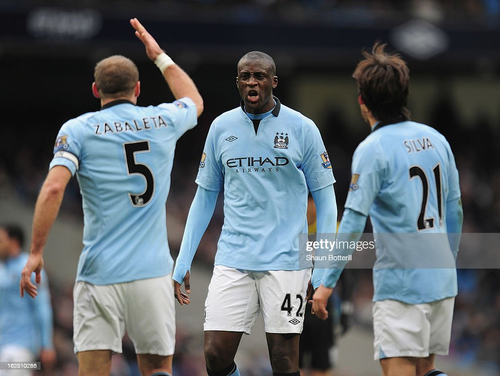 Yaya Toure of Manchester City exchanges words with team-mate Pablo Zabaleta during the Barclays Premier League match between Manchester City and Chelsea at Etihad Stadium on February 24, 2013 in Manchester, England.