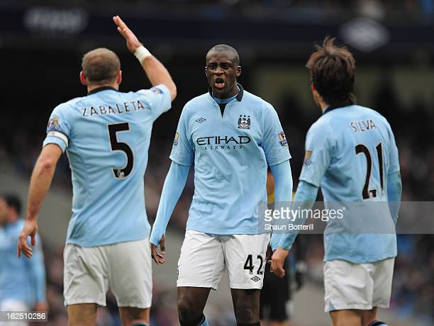 Yaya Toure of Manchester City exchanges words with team-mate Pablo Zabaleta during the Barclays Premier League match between Manchester City and...