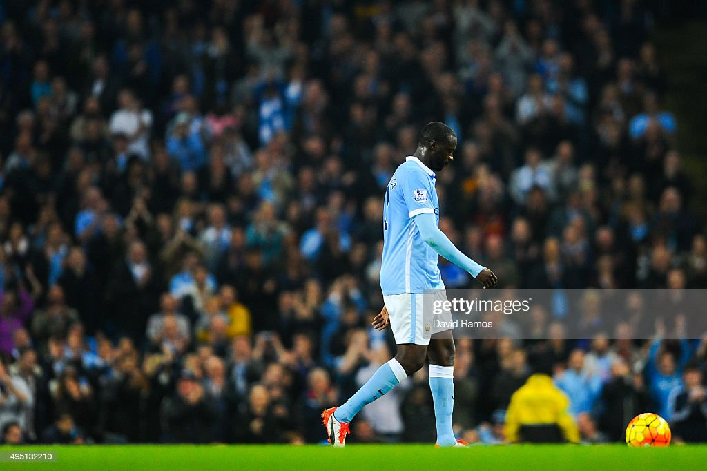 Yaya Toure of Manchester City FC looks down as he walks out the pitch being substituted during the Barclays Premier League match between Manchester City and Norwich City at Etihad Stadium on October 31, 2015 in Manchester, England.