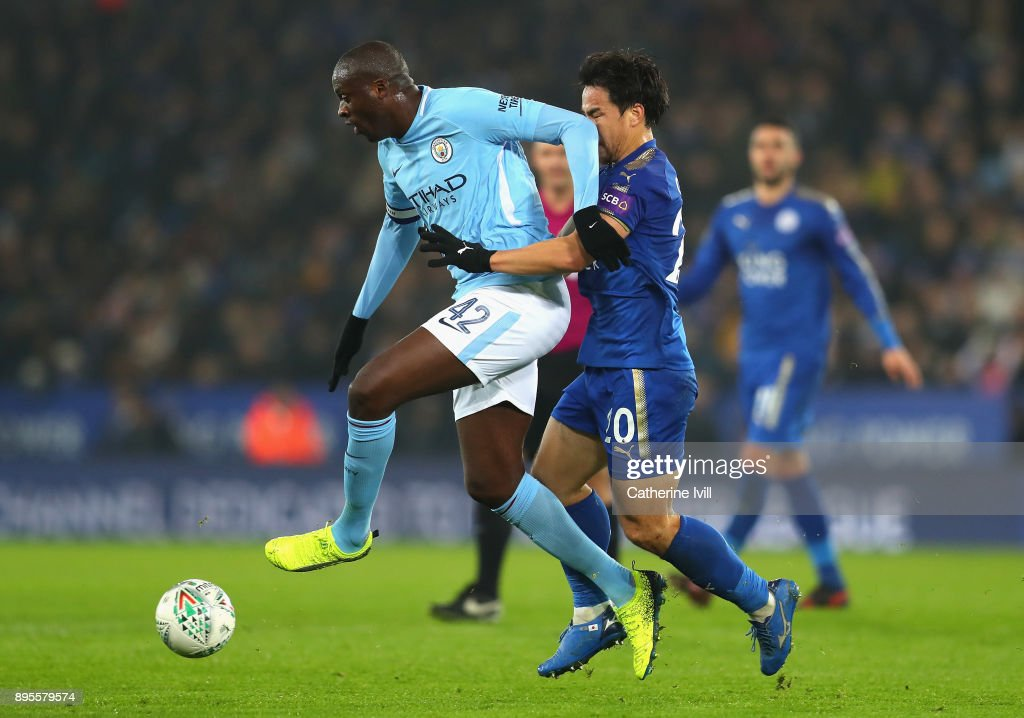 Yaya Toure of Manchester City fends off Shinji Okazaki of Leicester City during the Carabao Cup Quarter-Final match between Leicester City and Manchester City at The King Power Stadium on December 19, 2017 in Leicester, England.