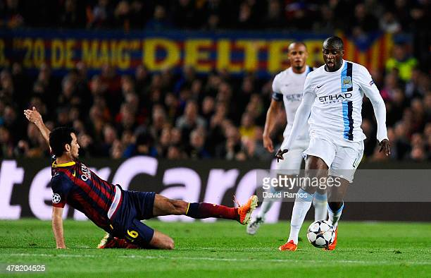 Yaya Toure of Manchester City goes past the challenge from Pedro of Barcelona during the UEFA Champions League Round of 16, second leg match between...