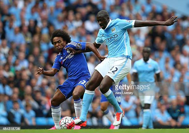 Yaya Toure of Manchester City holds off Willian of Chelsea during the Barclays Premier League match between Manchester City and Chelsea at Etihad...