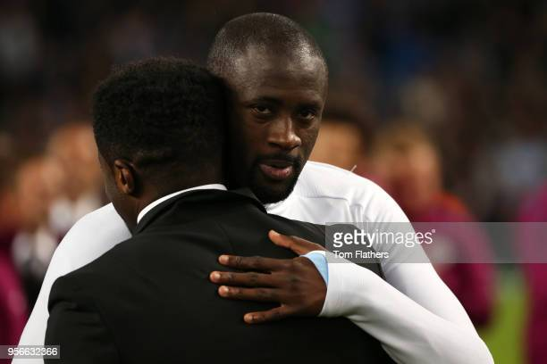 Yaya Toure of Manchester City hugs his brother Kolo Toure after the Premier League match between Manchester City and Brighton and Hove Albion at...