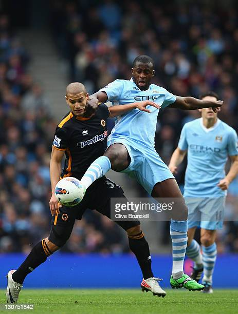 Yaya Toure of Manchester City in action with Adlene Guedioura of Wolverhampton Wanderers during the Barclays Premier League match between Manchester...