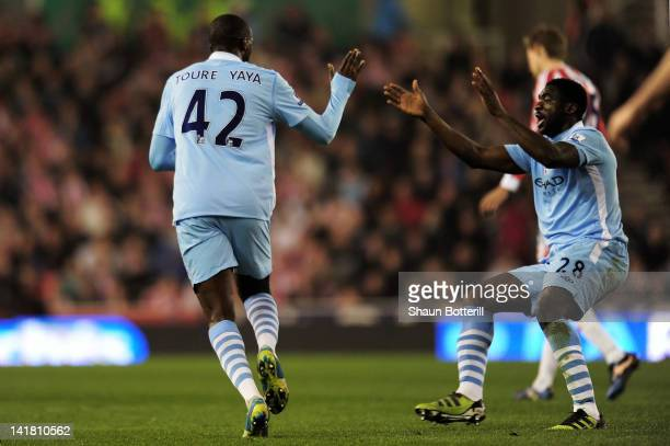 Yaya Toure of Manchester City is congratulated by teammate Kolo Toure after scoring a goal to level the scores at 1-1 during the Barclays Premier...