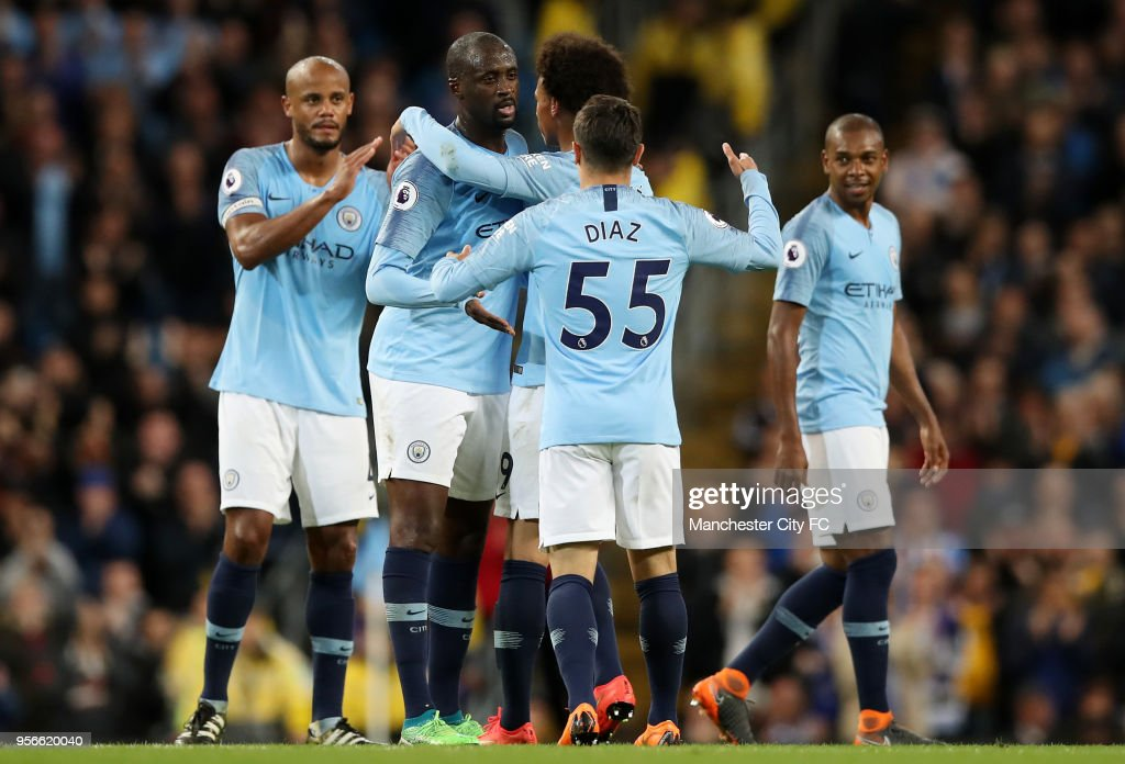 Yaya Toure of Manchester City is congrulated by his team mates before he is subbed during the Premier League match between Manchester City and Brighton and Hove Albion at Etihad Stadium on May 9, 2018 in Manchester, England.