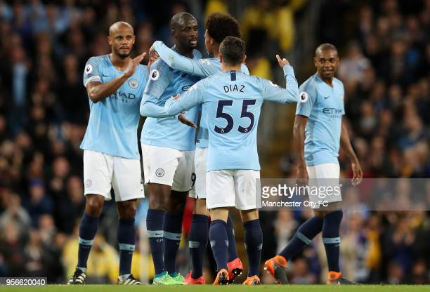 Yaya Toure of Manchester City is congrulated by his team mates before he is subbed during the Premier League match between Manchester City and...