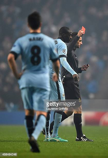 Yaya Toure of Manchester City is shown a red card by Referee Tasos Sidriopoulos during the UEFA Champions League Group E match between Manchester...