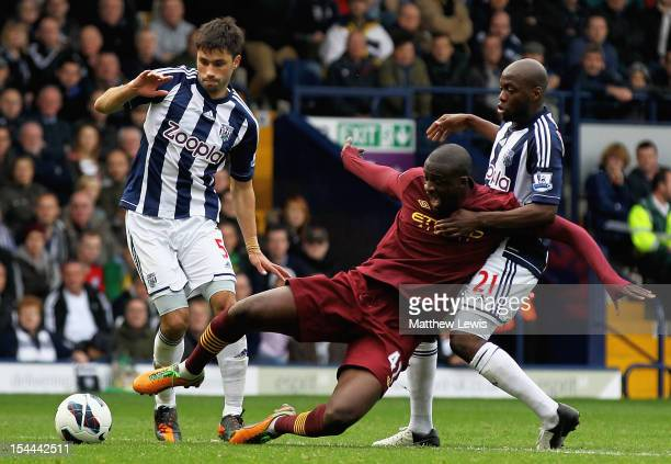 Yaya Toure of Manchester City is tackled by Youssouf Mulumba and Claudio Yacob of West Bromwich Albion during the Barclays Premier League match...
