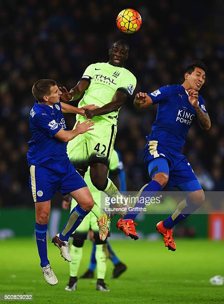 Yaya Toure of Manchester City jumps between Marc Albrighton and Leonardo Ulloa of Leicester City during the Barclays Premier League match between...