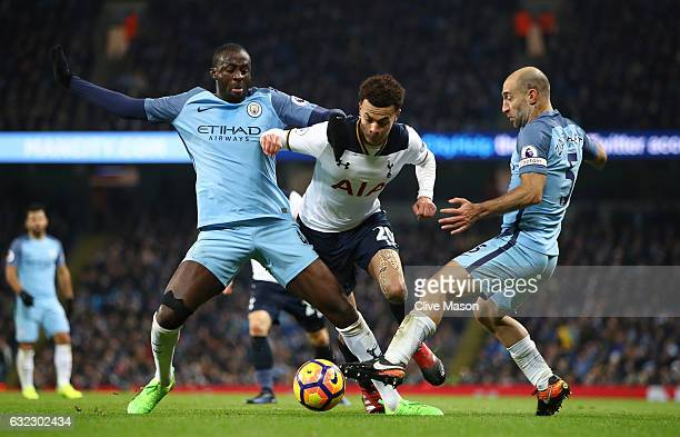 Yaya Toure of Manchester City nd Pablo Zabaleta of Manchester City tackle Dele Alli of Tottenham Hotspur during the a Premier League match between...