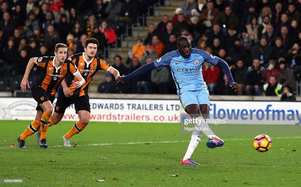 Yaya Toure of Manchester City scores from the penalty spot for his team's first goal during the Premier League match between Hull City and Manchester City at KCOM Stadium on December 26, 2016 in Hull, England.