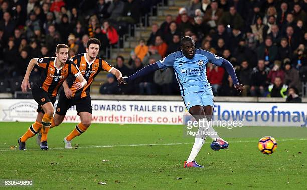Yaya Toure of Manchester City scores from the penalty spot for his team's first goal during the Premier League match between Hull City and Manchester...
