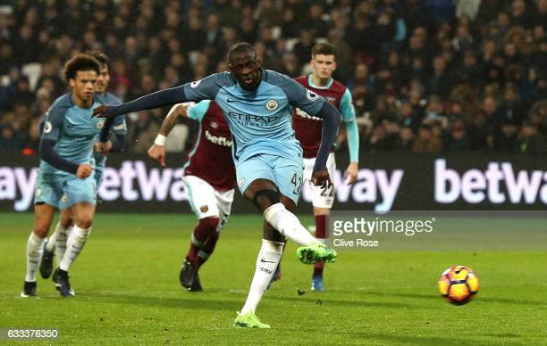 Yaya Toure of Manchester City scores from the penalty spot for his team's fourth goal during the Premier League match between West Ham United and...