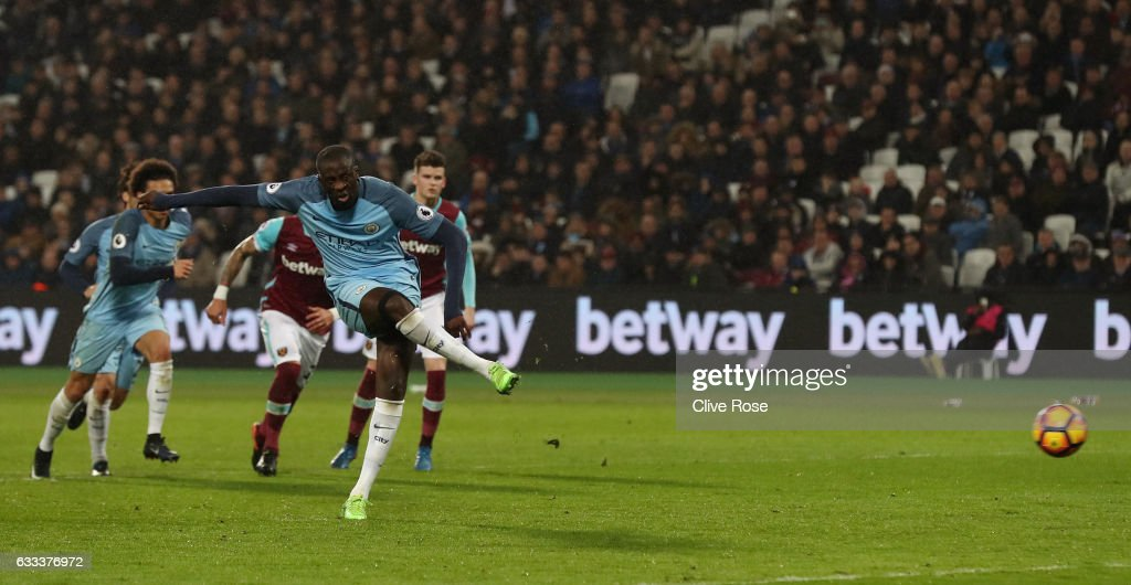 Yaya Toure of Manchester City scores from the penalty spot for his team's fourth goal during the Premier League match between West Ham United and Manchester City at London Stadium on February 1, 2017 in Stratford, England.