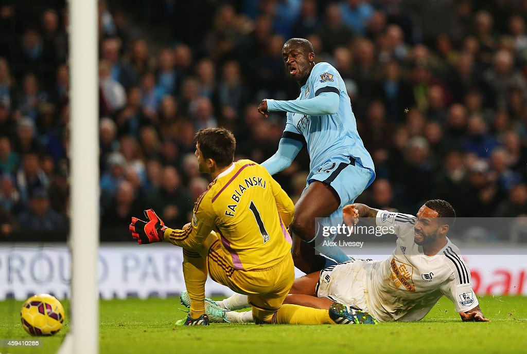 Yaya Toure of Manchester City scores his goal during the Barclays Premier League match between Manchester City and Swansea City at Etihad Stadium on November 22, 2014 in Manchester, England.