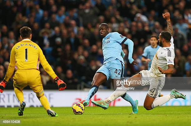 Yaya Toure of Manchester City scores his goal during the Barclays Premier League match between Manchester City and Swansea City at Etihad Stadium on...