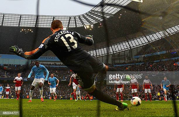 Yaya Toure of Manchester City scores his second goal from the penalty spot past David Stockdale of Fulham during the Barclays Premier League match...