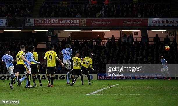 Yaya Toure of Manchester City scores his side's first goal during the Barclays Premier League match between Watford and Manchester City at Vicarage...