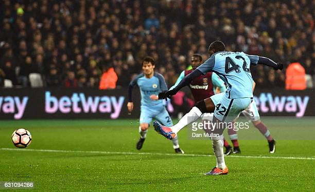 Yaya Toure of Manchester City scores his sides first goal from the penalty spot during The Emirates FA Cup Third Round match between West Ham United...