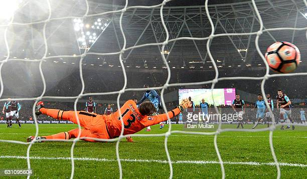 Yaya Toure of Manchester City scores his sides first goal from the penalty spot past Adrian of West Ham United during The Emirates FA Cup Third Round...