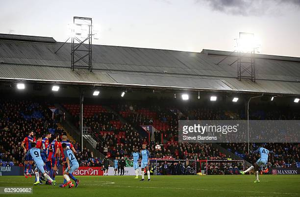 Yaya Toure of Manchester City scores his sides third goal from a free kick during the Emirates FA Cup Fourth Round match between Crystal Palace and...