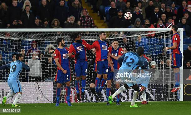 Yaya Toure of Manchester City scores his side's third goal from a free kick during the Emirates FA Cup Fourth Round match between Crystal Palace and...