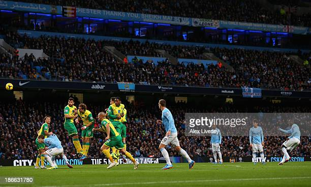 Yaya Toure of Manchester City scores his team's fifth goal during the Barclays Premier League match between Manchester City and Norwich City at...