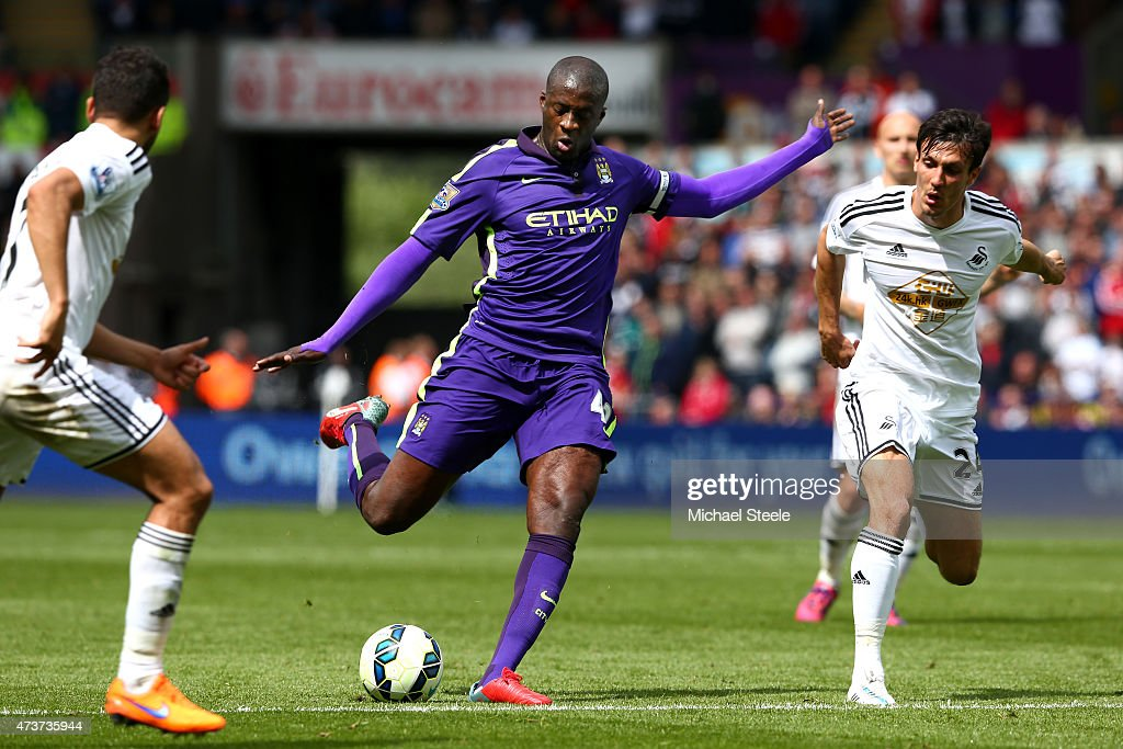 Yaya Toure of Manchester City scores his team's third goal during the Barclays Premier League match between Swansea and Manchester City at the Liberty Stadium on May 17, 2015 in Swansea, Wales.