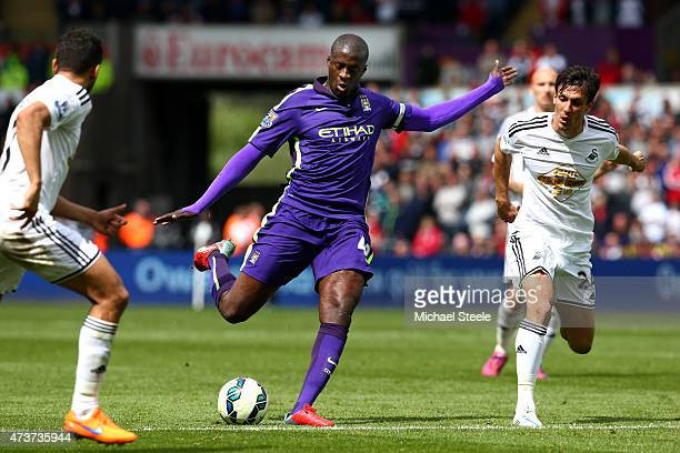 Yaya Toure of Manchester City scores his team's third goal during the Barclays Premier League match between Swansea and Manchester City at the...