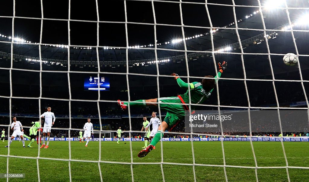Yaya Toure (2nd L) of Manchester City scores his team's third goal past outstretched goalkeeper Oleksandr Shovkovskiy of Dynamo Kiev during the UEFA Champions League round of 16, first leg match between FC Dynamo Kyiv and Manchester City FC at the Olympic Stadium on February 24, 2016 in Kiev, Ukraine.