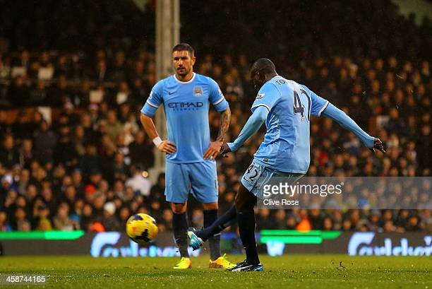 Yaya Toure of Manchester City scores the first goal from a freekick during the Barclays Premier League match between Fulham and Manchester City at...