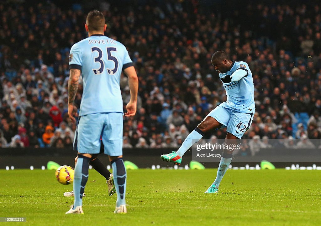 Yaya Toure of Manchester City scores the opening goal during the Barclays Premier League match between Manchester City and Sunderland at Etihad Stadium on January 1, 2015 in Manchester, England.