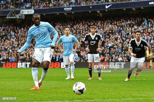 Yaya Toure of Manchester City scores the opening goal from the penalty spot during the Barclays Premier League match between Manchester City and...