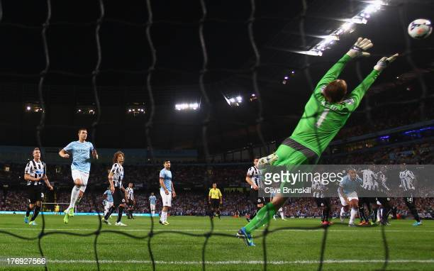 Yaya Toure of Manchester City scores the third goal from a free kick past Tim Krul of Newcastle United during the Barclays Premier League match...