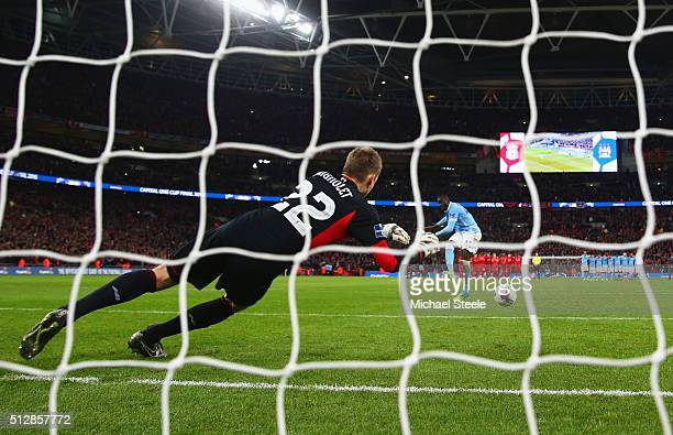 Yaya Toure of Manchester City scores the winning penalty past goalkeeper Simon Mignolet of Liverpool to win the shoot out during the Capital One Cup...