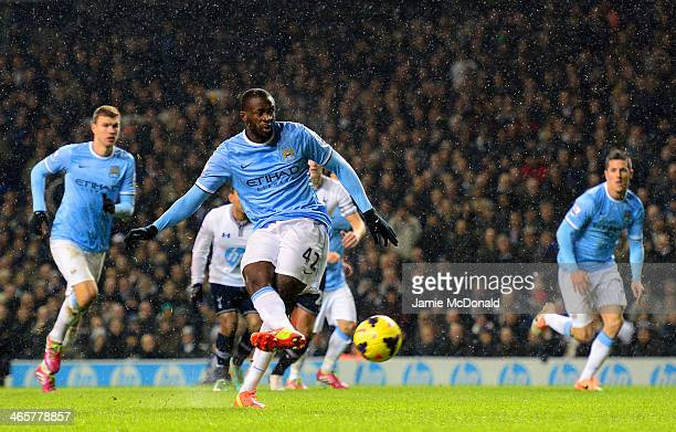 Yaya Toure of Manchester City scores their second goal from the penalty spot during the Barclays Premier League match between Tottenham Hotspur and...