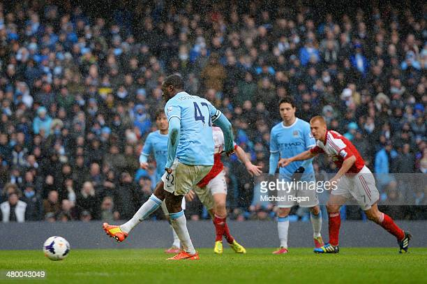 Yaya Toure of Manchester City scores their second goal from the penalty spot during the Barclays Premier League match between Manchester City and...