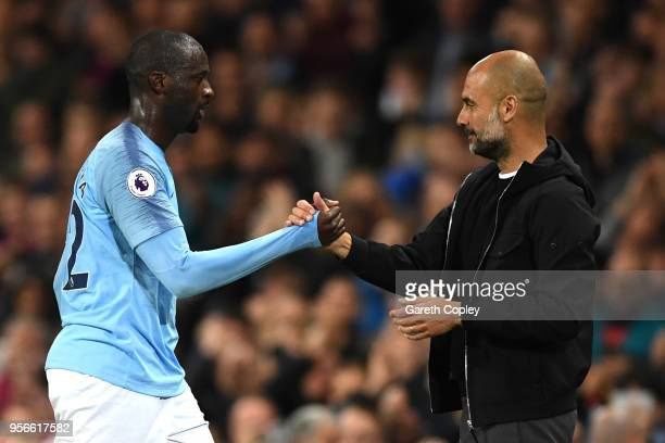 Yaya Toure of Manchester City shakes hands wtih Josep Guardiola Manager of Manchester City after he is subbed off during the Premier League match...