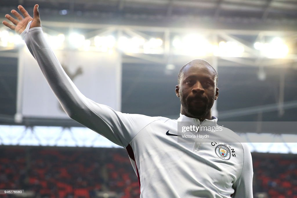 https://media.gettyimages.com/photos/yaya-toure-of-manchester-city-shows-appreciation-to-the-fans-as-he-picture-id946276580