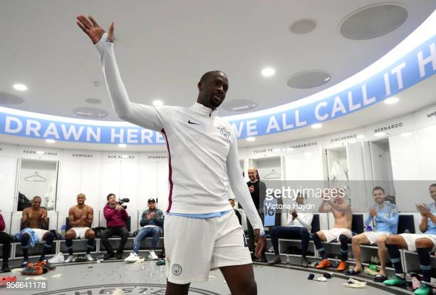 Yaya Toure of Manchester City speaks to his team mates in the dressing room after the Premier League match between Manchester City and Brighton and...