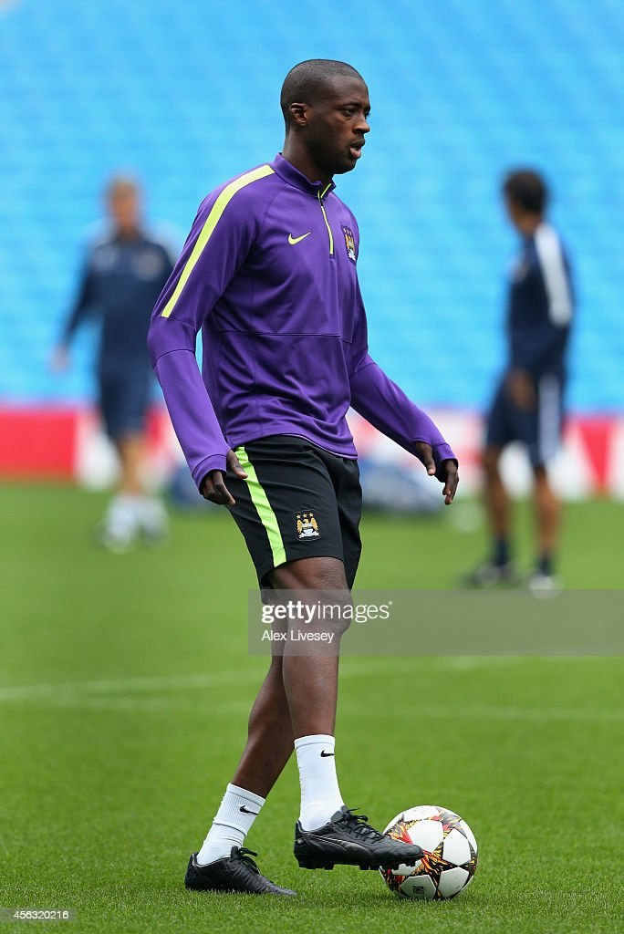 Yaya Toure of Manchester City warms up during a training session at the Etihad Stadium on September 29, 2014 in Manchester, England.
