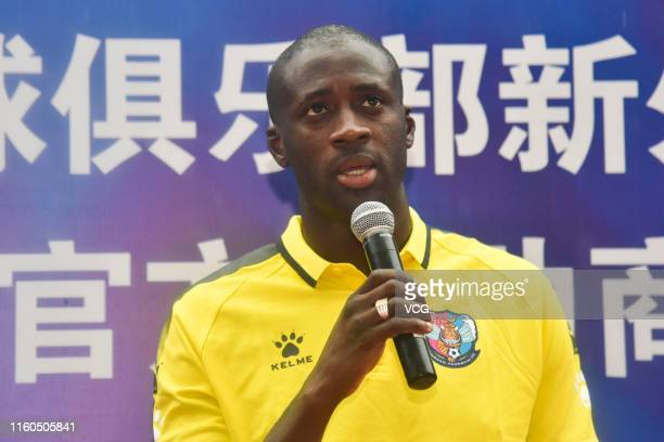 Yaya Toure of Qingdao Huanghai meets fans prior to the 16th round match of 2019 China League One between Qingdao Huanghai and Zhejiang Greentown at...