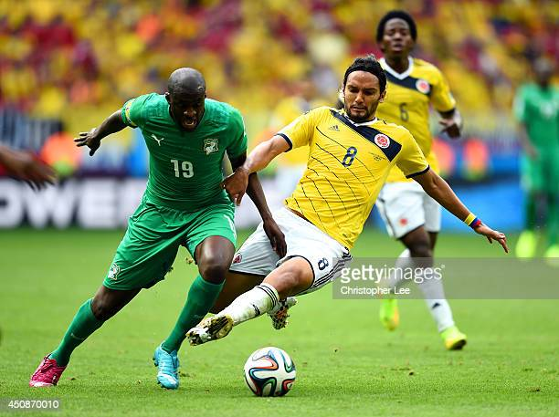 Yaya Toure of the Ivory Coast and Abel Aguilar of Colombia compete for the ball during the 2014 FIFA World Cup Brazil Group C match between Colombia...