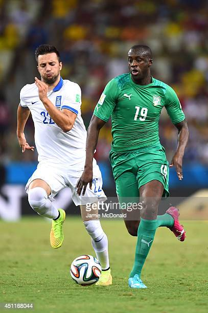 Yaya Toure of the Ivory Coast controls the ball against Andreas Samaris of Greece during the 2014 FIFA World Cup Brazil Group C match between Greece...