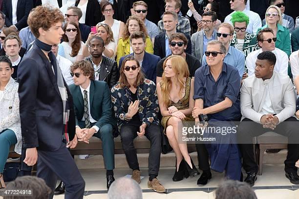 Yayako Uchida Josh Whitehouse Oscar Tuttiett Clara Paget Mario Testino and John Boyega sit in the front row at Burberry Menswear Spring/Summer 2016...